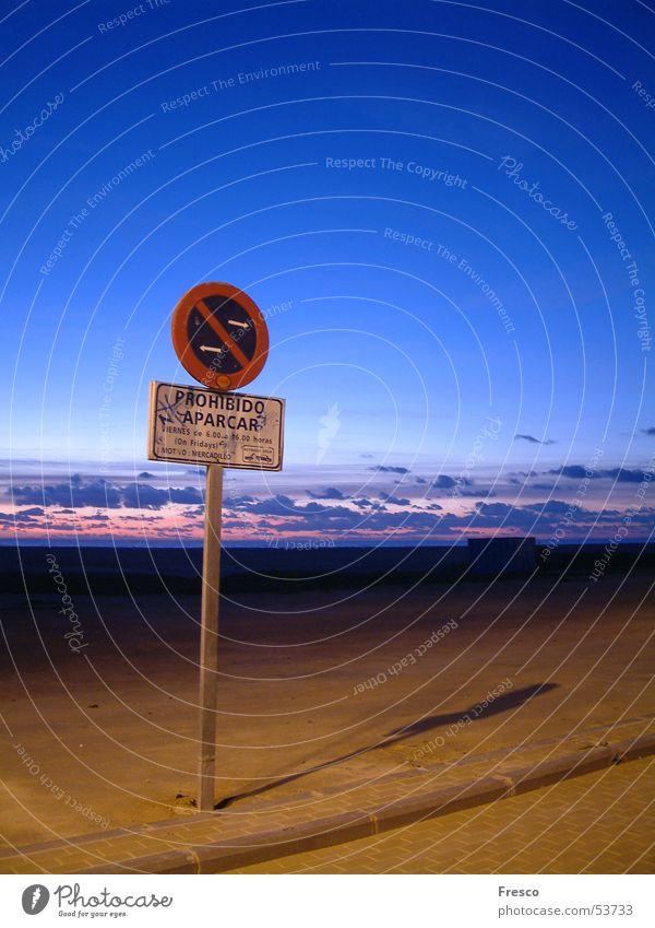 Parking Forbidden Parking sign Bans Clouds Beach Sunset Twilight Spain Coast tow Sky Sand