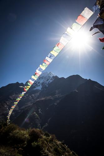 Nepal Nature Culture Prayer flags Religion and faith Himalayas Mountain Snowfall Sunlight Peak Multicoloured Sky Flag Colour photo Exterior shot Deserted Day