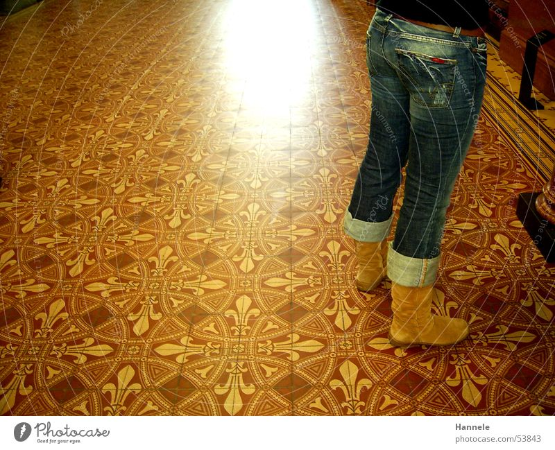 Human being Legs Jeans Hind quarters Pants Tile Boots Museum Backwards Footwear