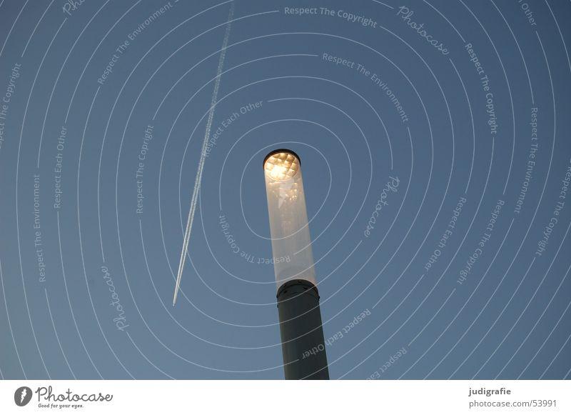 Airplane encounters streetlight Lamp Lantern Vapor trail Light Stripe Line Scratch mark Sky Evening Blue Crazy Aviation Beautiful weather Exterior shot
