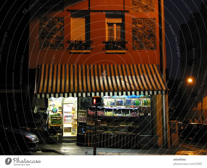 Vegetable shop in Meudon near Paris Night Sun blind Light France Europe Store premises Rain
