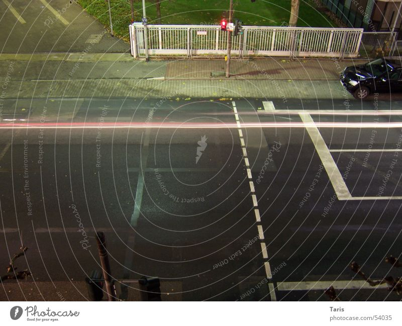 Drive on the line Night Traffic light Red Lighting Sidewalk Speed Fence White Stripe Long exposure Leadfoot Car race Dangerous Exterior shot Bird's-eye view