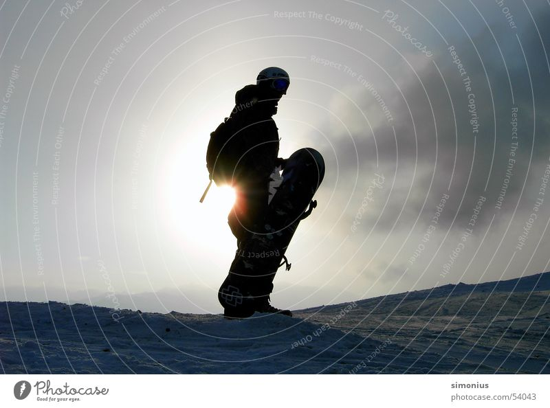 Hm, where do I have to go now? Snowboard Snowboarder Back-light Clouds Ski run Sun Exterior shot Carrying 1 Colour photo Silhouette Winter sun Winter sports