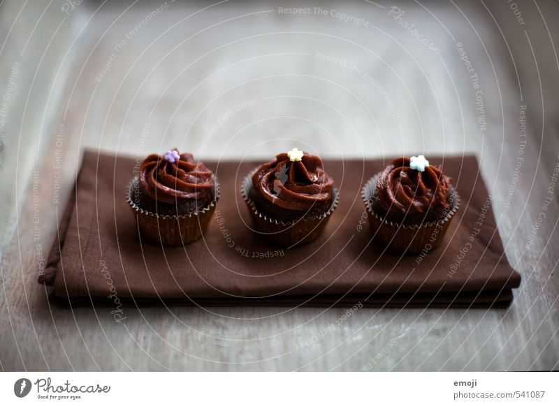 in threes Cake Dessert Candy Chocolate Nutrition Slow food Finger food Delicious Sweet Brown 3 Cupcake Rich in calories Colour photo Subdued colour