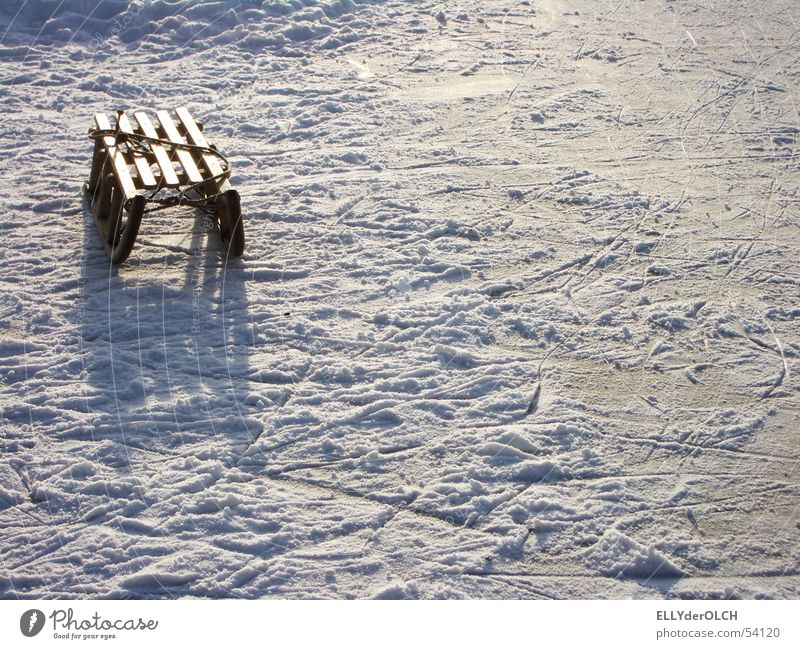 Blinding Childhood Lake Sleigh Winter Leisure and hobbies Afternoon Playing Dazzle Reflection Loneliness Sledding Cold Ice Shadow Individual Tracks Snow Sledge