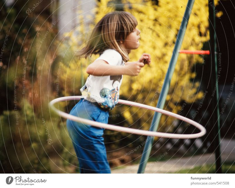 young girl with hula hoop Playing Fitness Sports Training Girl 1 Human being 8 - 13 years Child Infancy Bangs Tire Rotate Growth Thin Happiness Healthy