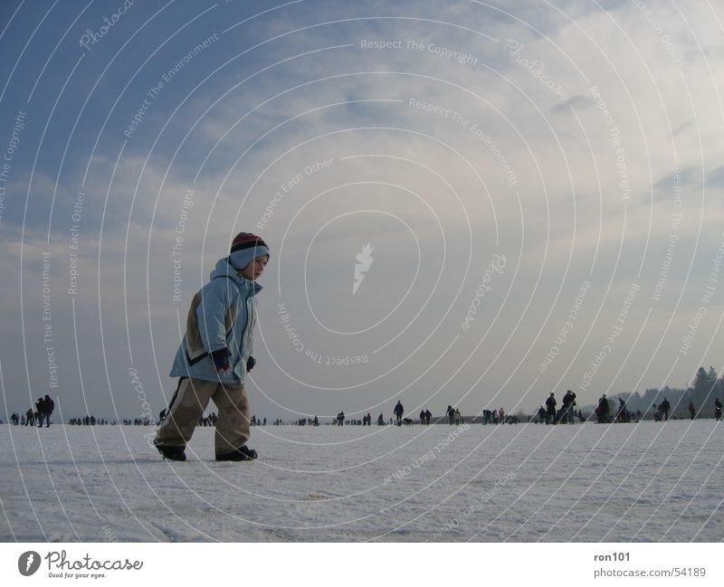 Human being Child Sky White Blue Winter Clouds Cold Snow Boy (child) Lake Ice Pants Jacket Frozen Cap