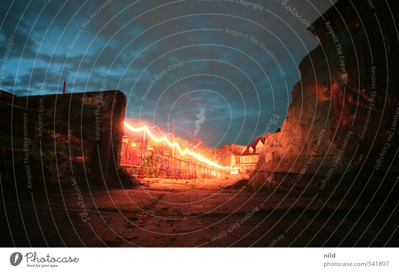 breakthrough Sky Clouds Night sky Industrial plant Ruin Architecture Wall (barrier) Wall (building) Blue Red Concrete Fairy lights Twilight Graffiti Uninhabited