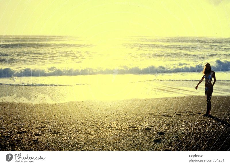 Woman Sun Ocean Beach Loneliness Relaxation Yellow Coast Sand Waves Individual Summer vacation Dusk Surf Atlantic Ocean Sandy beach