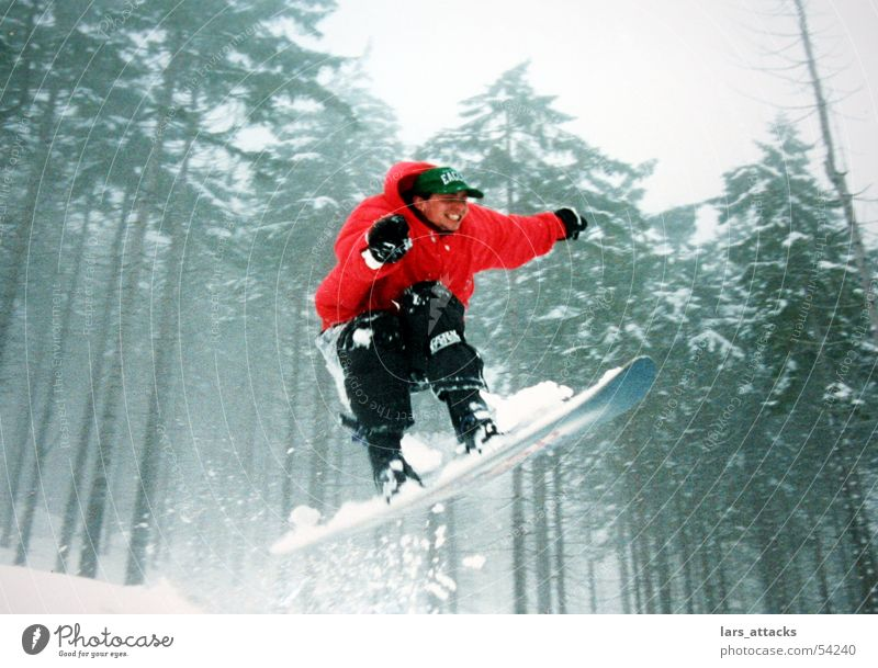 leap of luck Jump Snowboard Winter Air Red Forest Ski jump Winter sports Thrill Joy Funsport Enthusiasm Tall far Speed Bright Colours 1 Snowboarder Snowboarding