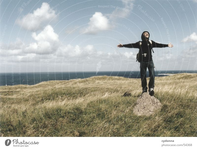 Human being Man Sky Ocean Summer Clouds Meadow Emotions Freedom Stone Landscape Wind Posture Facial expression North Sea Impression