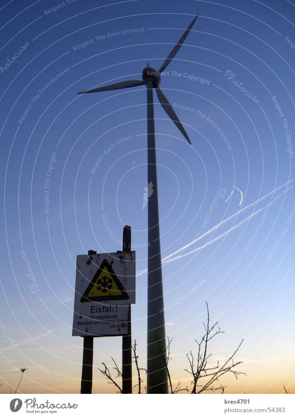 Dangerous wind power Wind energy plant Sunset Winter Warning sign Icefall Sky Blue sky Signs and labeling Threat enter at your own risk