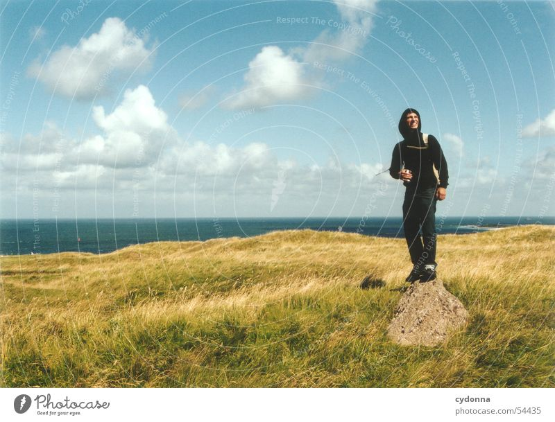Free Period II Man Posture Clouds Meadow Ocean Emotions Release Impression Summer Human being Freedom Landscape Sky Stone North Sea Helgoland Wind