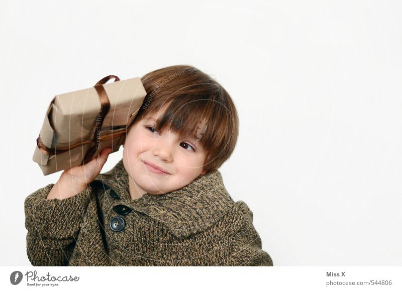 Human being Child Christmas & Advent Emotions Boy (child) Think Feasts & Celebrations Moody Birthday Infancy Gift Cute Curiosity Surprise Listening Brunette