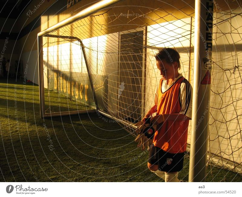 before the penalty shootout... Goalkeeper Gloves Hand Light Sunset Artificial lawn Jersey Red Yellow White Twilight Loneliness Meadow Green Soccer Goal