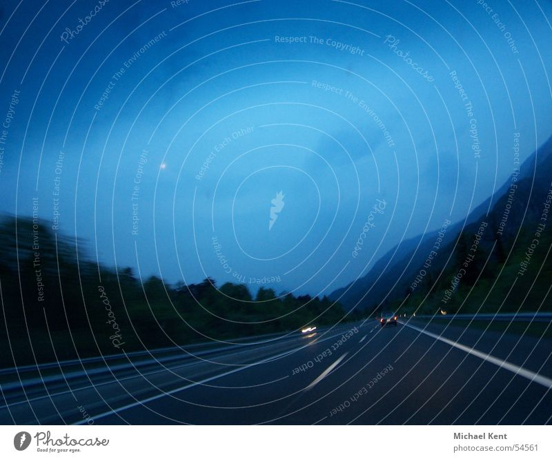 Motorway evening atmosphere Highway Driving Speed Twilight Switzerland Clouds Oncoming traffic Blue Dusk Evening Street Rain motion. track tempo.