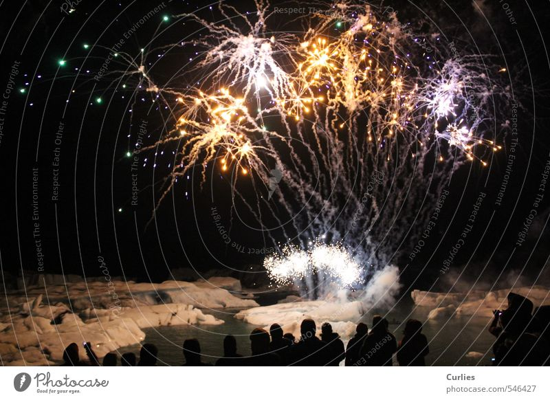 miracle of fire Vacation & Travel Adventure Human being Group Crowd of people Landscape Fire Water Night sky Ice Frost Snow Glacier Ocean Lake Illuminate Yellow