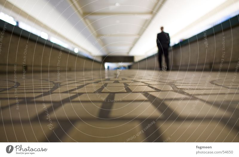 Human being Loneliness Lanes & trails Floor covering Pedestrian Underpass