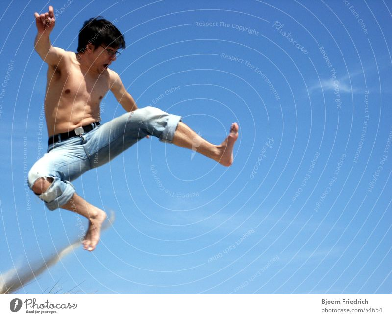 Human being Sky Man Blue Vacation & Travel Summer Jump Legs Feet Flying Skin Aviation Electricity Jeans Scream Dust