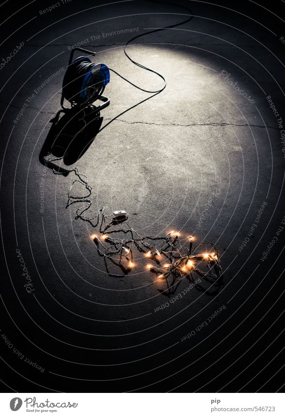 raw christmas cable drum Cable Switch Electric bulb Fairy lights Concrete Dark Cold Whimsical Floor covering Moody Lacking atmosphere Christmas & Advent