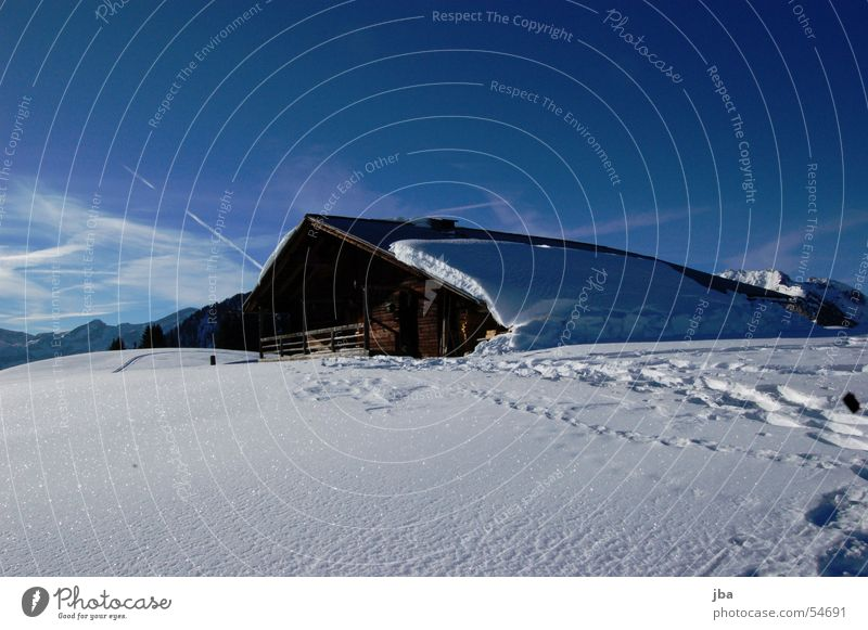 solitary Alpine pasture Agriculture Mountain farmer Wood House (Residential Structure) Barn Roof Snow Winter Ski tour Hut Farmer Glittering Sun Sky Clarity