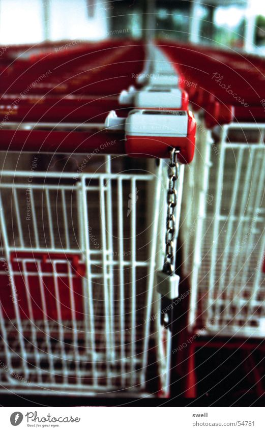 Tightly chained Shopping Trolley Supermarket Chain Row art