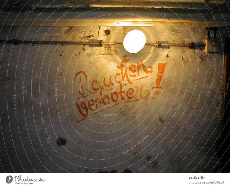 Dark Lamp Brown Signage Smoking Derelict Warning label Typography Bans Electric bulb Clue Text Cellar Flashy Underground