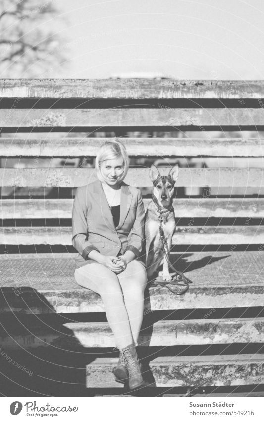 buddies Body 1 Human being Wall (barrier) Wall (building) Animal Dog Smiling Sit Friendship Love of animals Shepherd dog Blonde Young woman Black & white photo