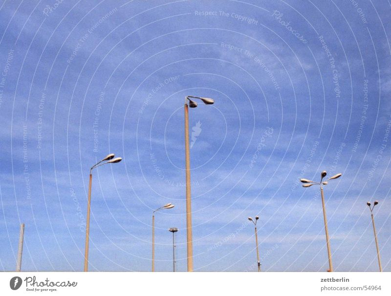 light poles Lantern Street lighting Parking lot lighting Floodlight Places Air Airy Detail Sky Lighting cirrostratus clouds Blue Freedom