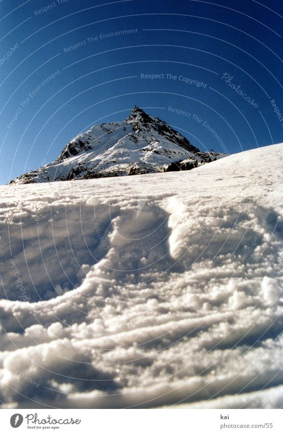 Nature Winter Snow Mountain Alps Peak Upward Beautiful weather Snowscape Ski run Portrait format Cloudless sky