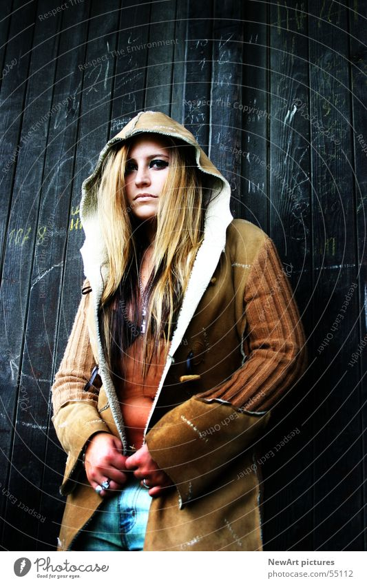 Woman Human being Face Eyes Wall (building) Wood Hair and hairstyles Fashion Brown Model Coat Hooded (clothing)