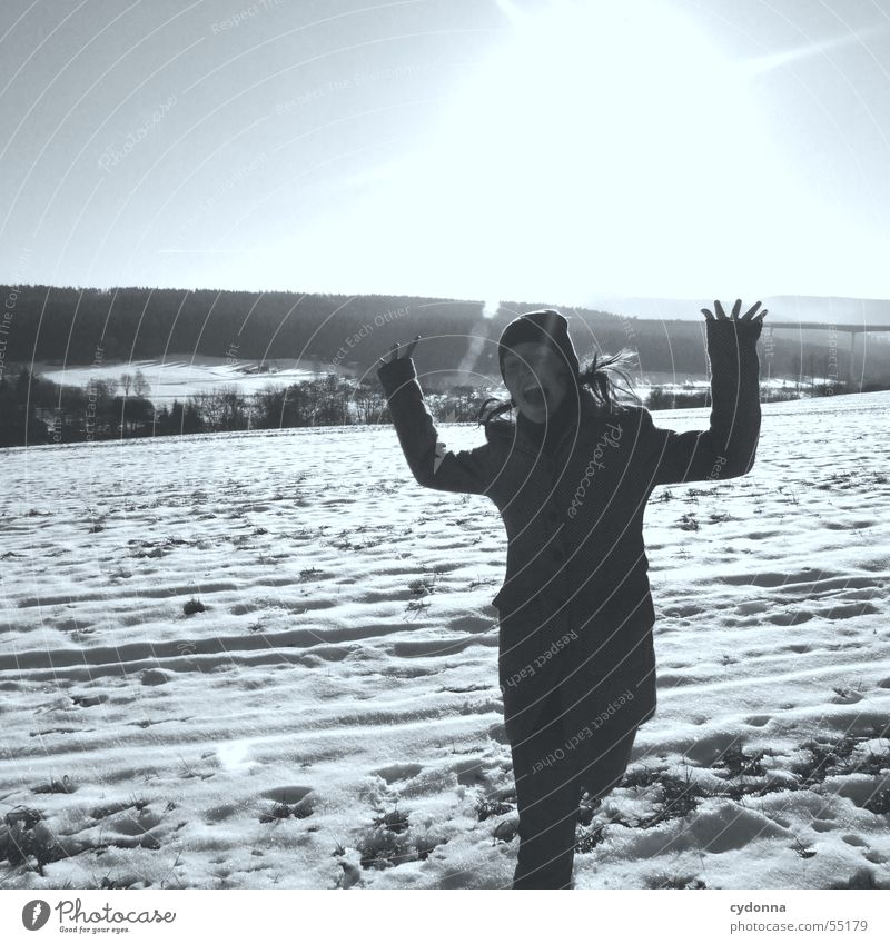 Human being Woman Sky Sun Joy Loneliness Winter Far-off places Landscape Snow Mountain Warmth Jump Lighting Field Large