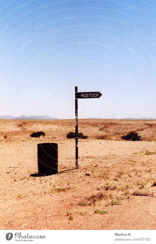 Rostock? Keg Namibia Funny Strange Hot Physics Dry Globalization Desert Empty nowhere somewhere Signs and labeling Road marking Namib desert Bird's colony