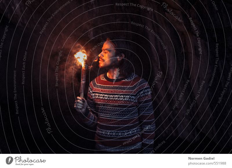 fiery Human being Young man Youth (Young adults) Man Adults 1 18 - 30 years Fire Rock Sweater Curiosity Warmth Cave Torch Discover Brave Search Light Dark Hot