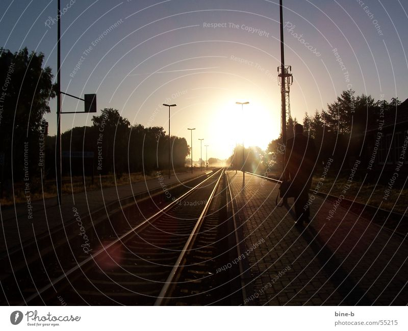 Vacation & Travel Calm Freedom Sadness Lighting Fog Idyll Village Railroad tracks Train station Snapshot Dazzle Suitcase Single-minded Impaired consciousness