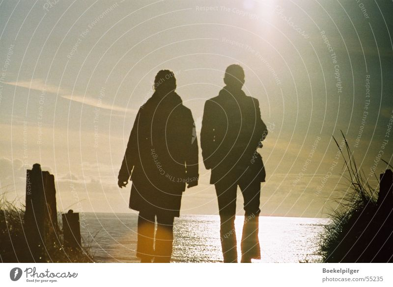 beach walk Beach Romance Sunset Back-light Ocean Woman Together Human being Nature Sky To go for a walk Love