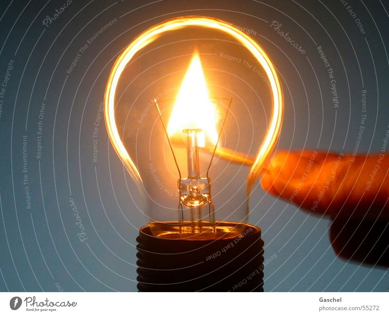 Dark Bright Lamp Lighting Blaze Fire Energy industry Hot Electric bulb Match Energy crisis Save energy Energy-saving bulb Power failure Energy saver