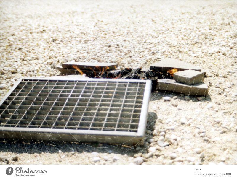 improvised grill Barbecue (apparatus) Bratwurst Beach Summer Grating Rust Stone Sun Blaze Metal
