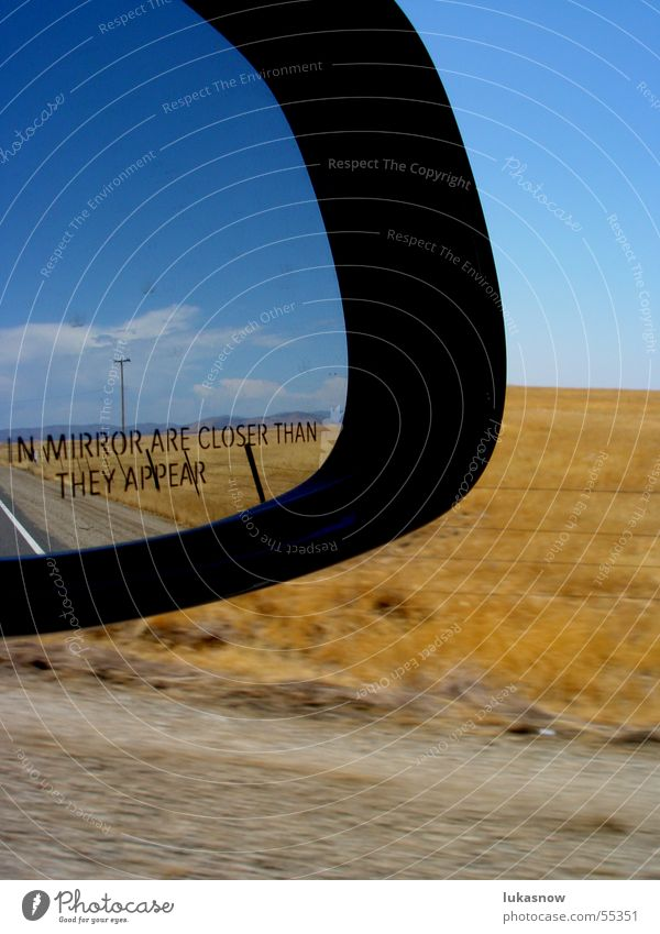 on the road Rear view mirror Mirror Grass Dry Speed Sky Clouds Vacation & Travel Driving Porsche Landscape Blue sky road trip shoulder
