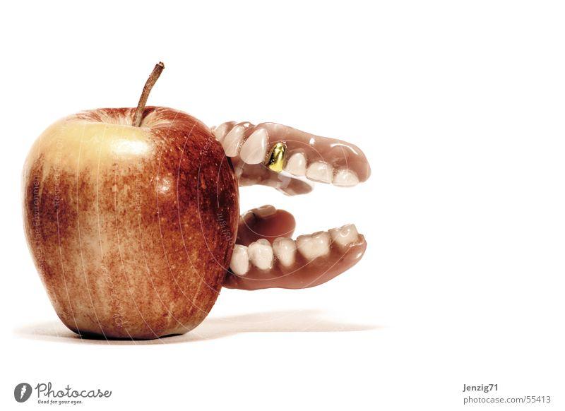 Bite hard. Gold tooth Prothesis Dental implant Adhesive cream Apple Fruit Nutrition Teeth