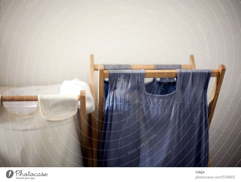 Housework | Sorting laundry Lifestyle Living or residing Interior design Laundry basket Sack Blue White Orderliness Arrangement Collection point