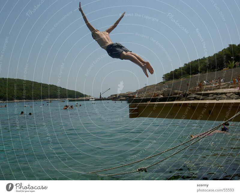 Gliding with water landing Ocean Jump Footbridge Leisure and hobbies Summer Springboard Croatia sea Water dive Island boy Joy fun leisure diving board