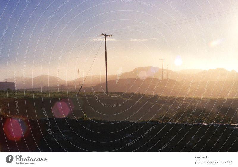 Nature Beautiful Sky Sun Wall (barrier) Bright Field Fog Environment Electricity Hill Electricity pylon Ireland