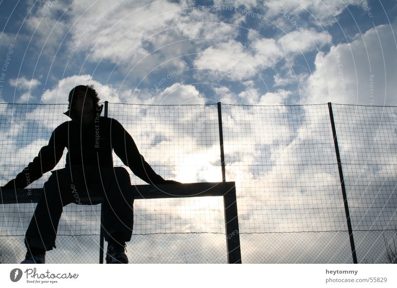 High fives & blue skies Clouds Football pitch Man Fence To enjoy Exterior shot Aachen Winter Think Relaxation Breathe Air Breathe in Infinity Sky Cozy Sit