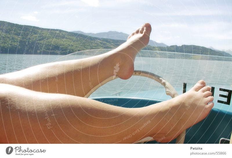 Foot handlebars Lake Steering wheel Watercraft Driving Conduct Toes Feet Mountain Sky Skin Legs Barefoot