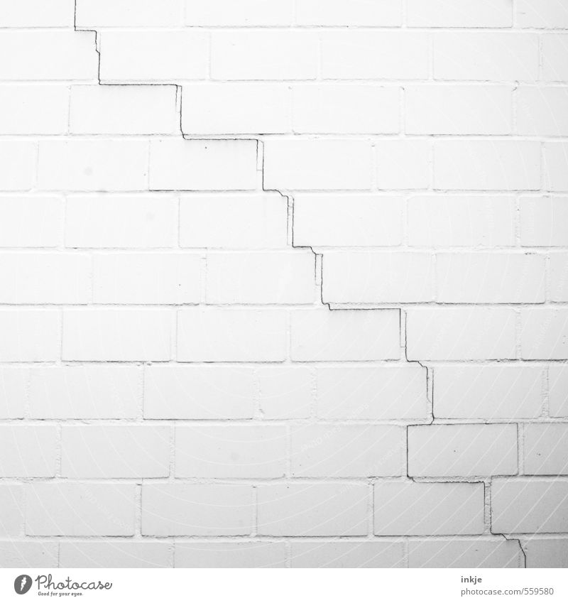 it's going downhill Deserted Wall (barrier) Wall (building) Facade Line Crack & Rip & Tear Level Old Thin Broken Long Black White Moody Decline Transience