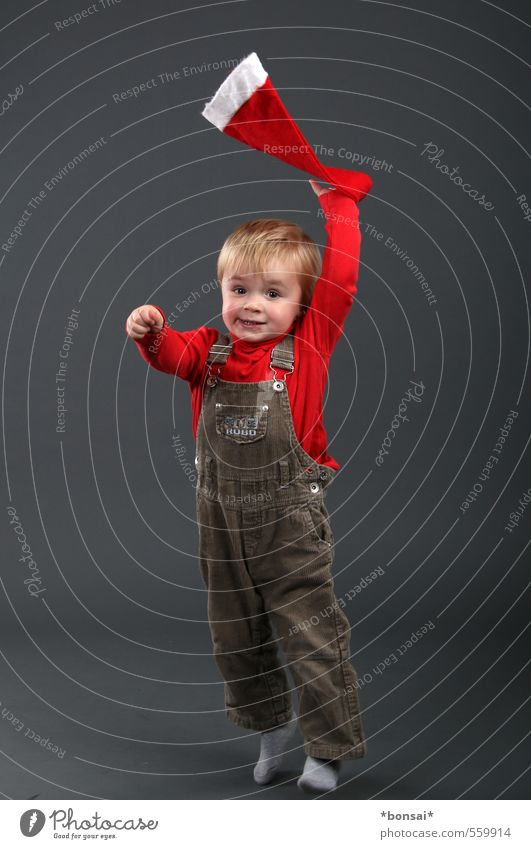 anticipation Playing Christmas & Advent Human being Child Toddler Boy (child) 1 1 - 3 years Overalls Cap Movement To hold on Smiling Jump Dance Throw Blonde