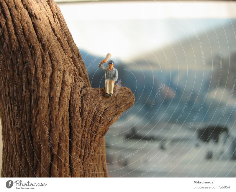 air snapper Manikin Railroad Toys Figure Mountain Wave Wood Tree trunk Background picture Painting and drawing (object) Image Salutation Above Air Newspaper Sit