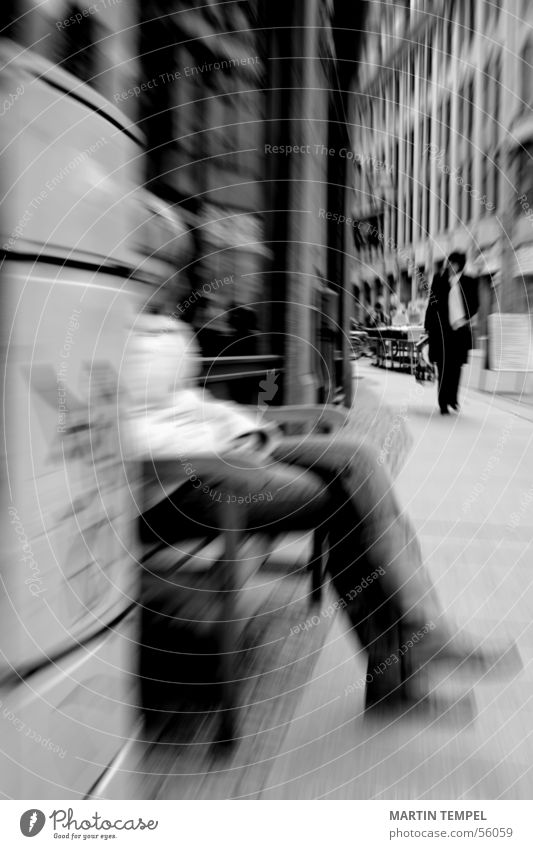 In peace lies strength. Black & white photo Exterior shot Blur Motion blur Woman Adults Legs Town Street Jacket Sit Sidewalk steep Bench