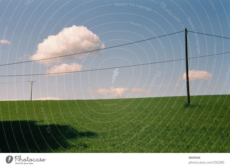cloudburst Clouds Sky Nature Landscape Electricity pylon Blue Green Horizon Far-off places Playing Lawn Transmission lines Beautiful weather Summer Minimal Calm